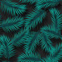 Vector trendy, fashionable seamless pattern. Big green exotic tropical palm leaves of banana or coconut trees on a black background