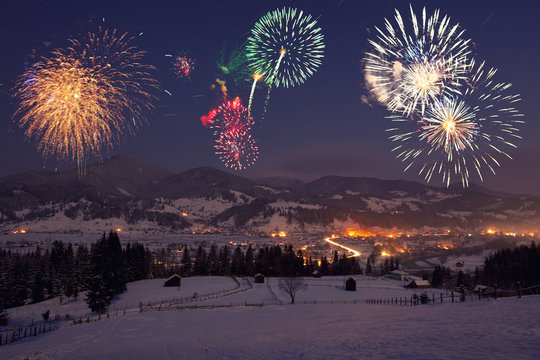 fireworks at mountain landscape. view of holiday city