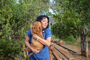 Woman dog breeder with brown African Mastiff Boerboel puppy