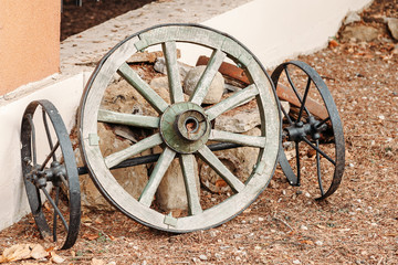 wheel of old wagon. parts from old broken wooden chariots