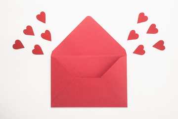 Red envelope with hearts on white background