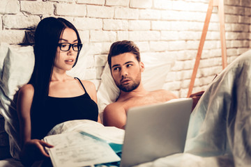 Young Couple in Bed, Girl Working Laptop Bored Man