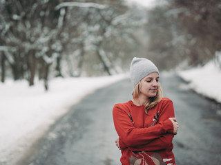 Portrait of cute blonde woman outdoor. Winter forest.