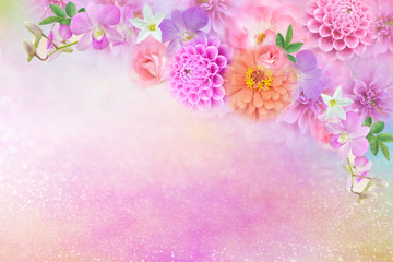 mix of colorful roses,dahlia and orchid flower border with copy space on glitter background for greeting valentine, wedding card