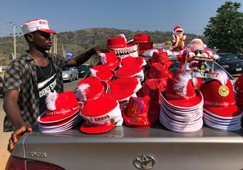Street vendor, Eko Onyewuchi, 35, sells Christmas items displayed on a car in Abuja