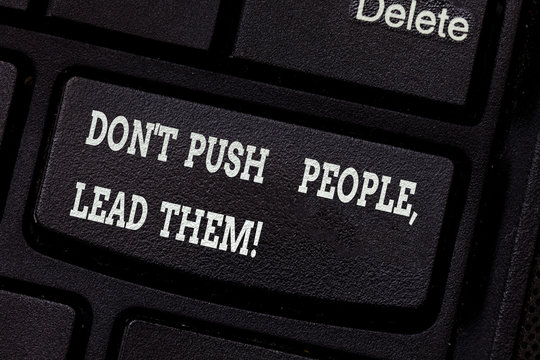 Writing note showing Don T Push People Lead Them. Business photo showcasing Be kind and motivate your staff to take action Keyboard key Intention to create computer message pressing keypad idea