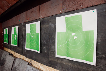 Shooting range gun. Paper target in white and green color for hit