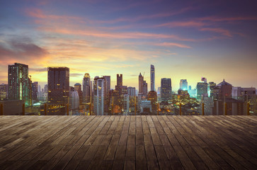 Fotomurales - Bangkok urban cityscape golden hour with empty wooden floor on front