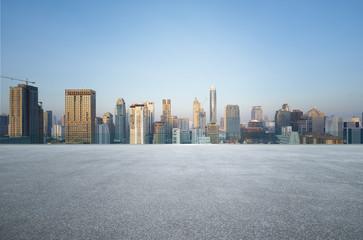 Fotomurales - Bangkok urban cityscape skyline morning scene with empty asphalt floor on front