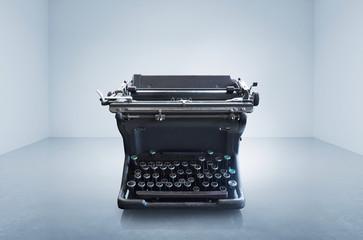 Old vintage retro black Typewriter on empty space