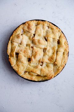 Overhead view of baked apple pie on marble