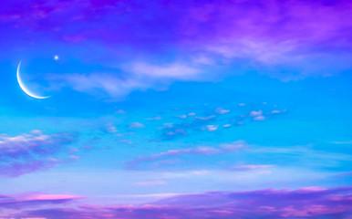 Crescent moon with beautiful sunset background . Generous Ramadan . Light in dark sky .  Religion background  .  beautiful sky . Prayer time .
