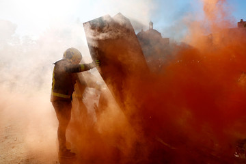 Firemen take part in a protest in front of Catalunya's Parliament in Barcelona
