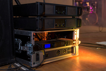 Photo of equipment for concert lighting, sound and scene in the background
