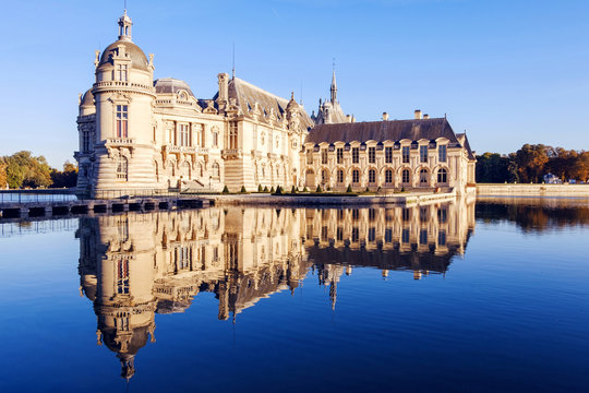 View of Chantilly castle with reflection