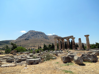 Europe, Greece, Corinth,remains of an ancient temple on the background of a mountain with a fortress