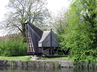 Europe, Belgium, West Flanders, Bruges, Old crane on the canal  Bank