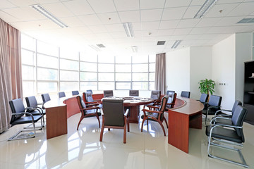 tables and chairs in a conference room