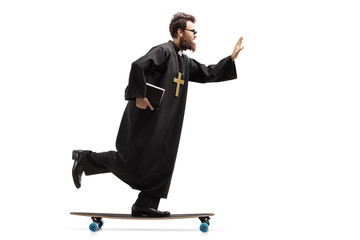 Young priest holding a bible and riding a longboard