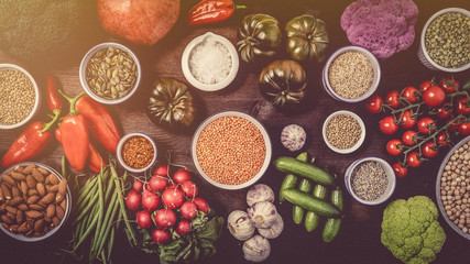 Winter vegetarian cooking ingredients,white wooden background, top view,.with different vegetables and legumes
