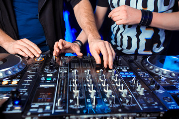 Music record  in inight club with male hands