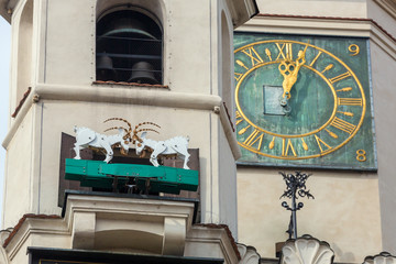 Tower of the City Hall on the Market square in Poznan, Poland. The mechanized goats, which are the symbol of the town, appearing once a day at noon