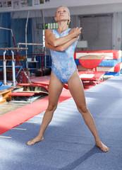 Woman training gymnastic elements
