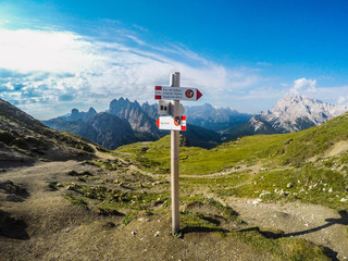 Breathtaking mountain landscape view of iconic Tre Cime di Lavaredo walking trail or Drei Zinnen, Sexten Dolomites, Italy in summer. Tourist popular spectacular attraction/destination in Europe