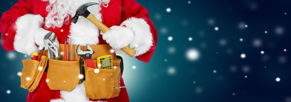 Santa Claus with a tool belt on winter background