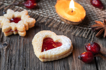 Linzer Christmas cookies on a rustic background