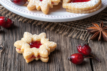 Linzer Christmas cookie on a rustic background