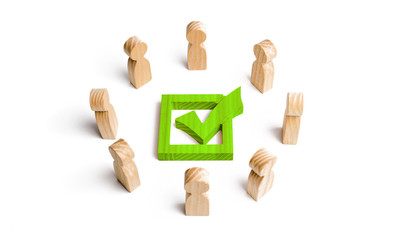 People stand in a circle and look at the green check mark in the box. election, poll or referendum. Poll people. Voters participate in elections of parliament or president, teamwork. Selective focus