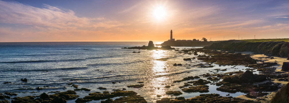 Panoramic view of the rocky shoreline close to the Pigeon Point Lighthouse on the Pacific Ocean coastline, sunset landscape; Pescadero, San Francisco bay area, California