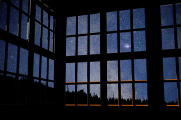 3d computer rendered illustration of windows over a photo I took of the milky way