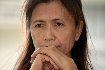 Worried Filipina Female Senior Grandmother