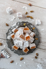 Turkish Delight candy on rustic plate flat lay
