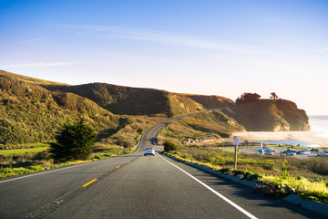 Driving on Highway 1 on the Pacific Ocean coastline close to Half Moon Bay, California