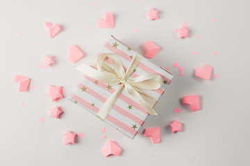 Paper pink hearts on white color backdrop