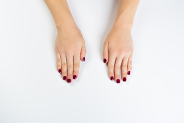 Top view photo of woman's hands with dark manicure