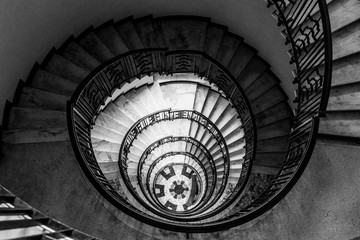 hypnotic pattern of a spiral staircase, monochrome