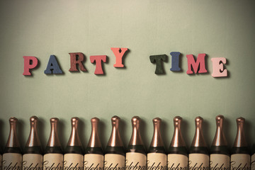 """""""Party Time"""" text with row of Champagne bottles. Party postcard"""