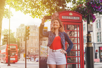 Photo on textile frame London red bus happy young girl taking a selfie in front of a phone box and a red bus in London