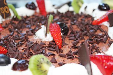 Birthday chocolate cake with strawberry decoration