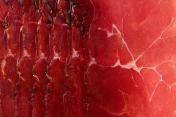 Prosciutto red meat dry pork ham texture closeup