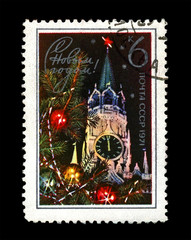 Kremlin tower with red star, decorated fir-tree for New Year, circa 1970. canceled vintage post stamp printed in the USSR isolated on black background.