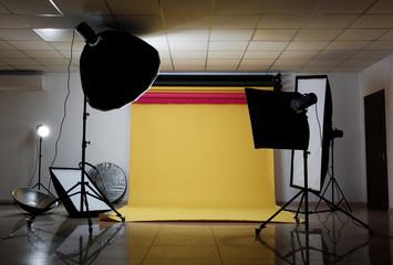 Interior of modern photo studio with professional lighting equipment