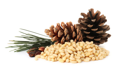 Heap of pine nuts and cones on white background