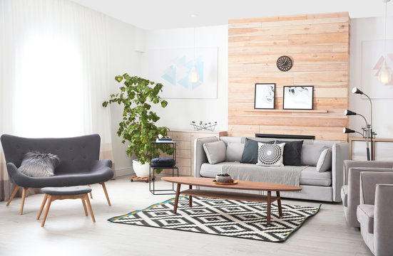 Stylish living room interior with comfortable couch and decorative elements
