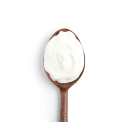 Wooden spoon with sour cream on white background, top view