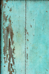 Old Wood door paint green color peeling texture background with copy space